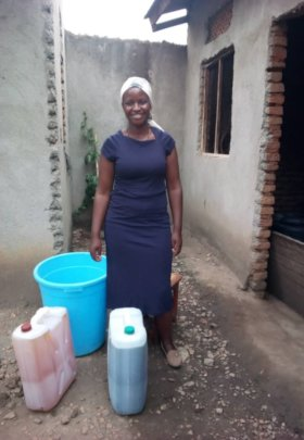 Yolesi with the liquid soap she produces.