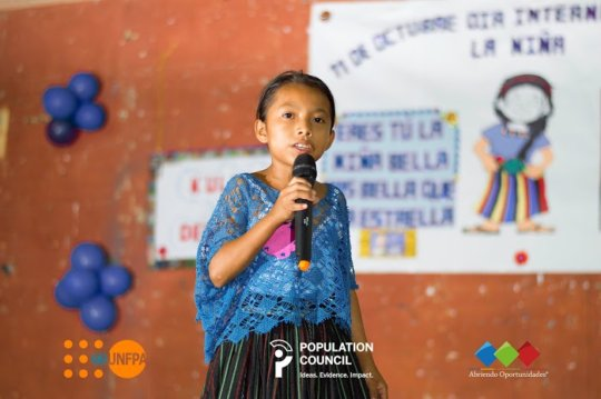 Young participant speaking in public.
