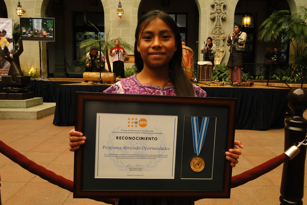 One AO girl holding the UNFPA medal
