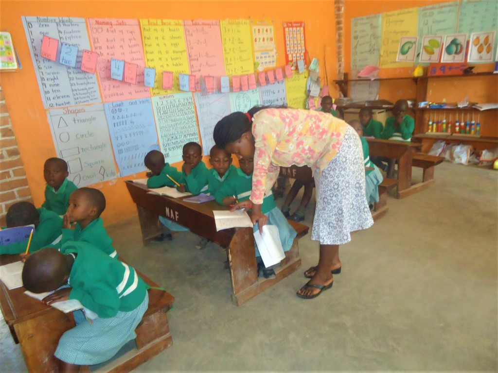 Kutamba nursery class listening to teacher Abia