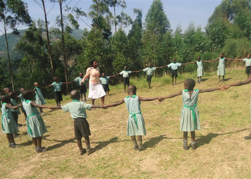 Abia and her nursery class playing outside