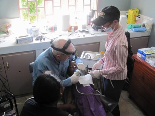 Dental volunteer providing care