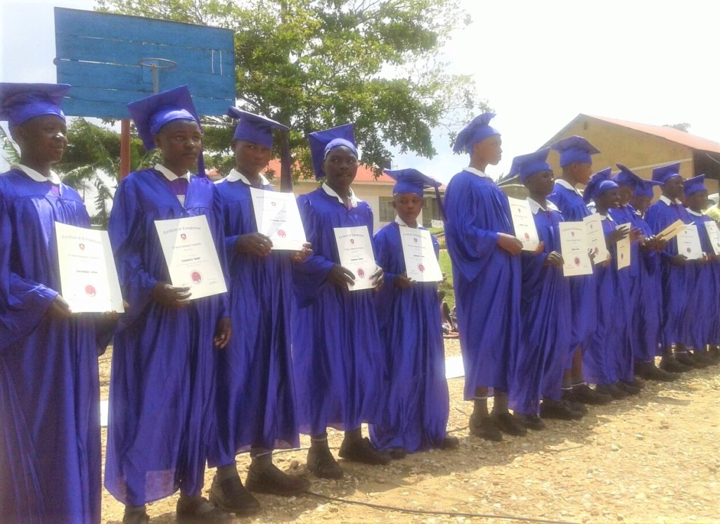 Students with their certificates of completion