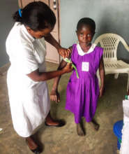 Nyaka student during a malnutrition assessment