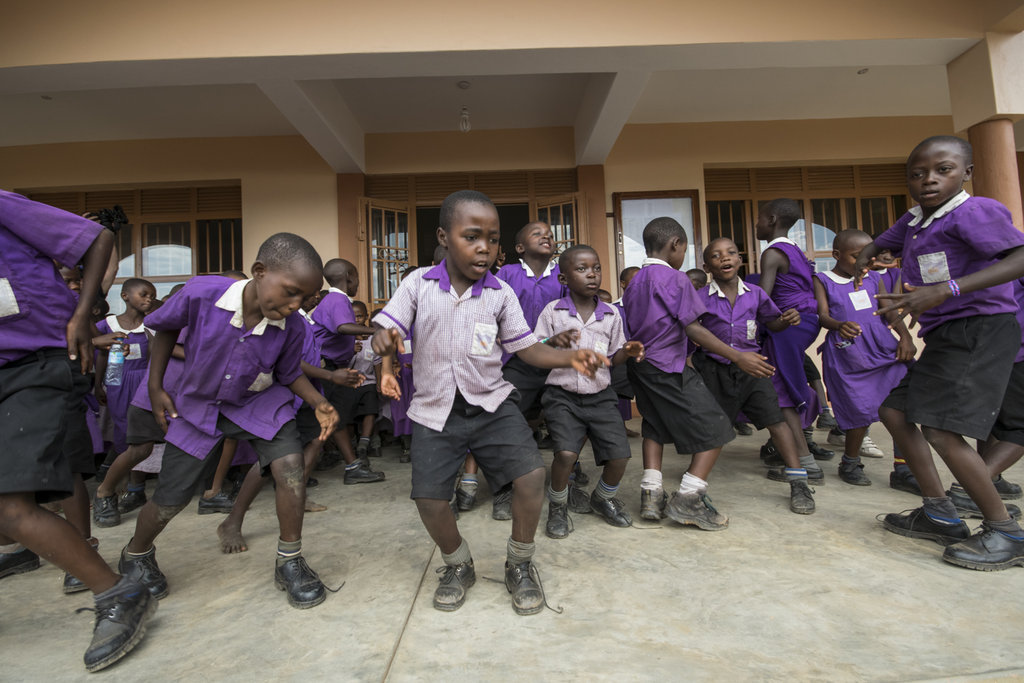 Primary students dancing at the celebration
