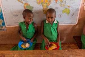 Children at Kutamba Primary School enjoying lunch