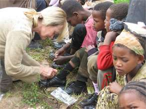 Sharon Daly providing children's shoes