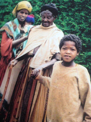 Ethiopian child leading two blind adults