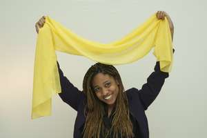 Each woman is given a HERA yellow scarf