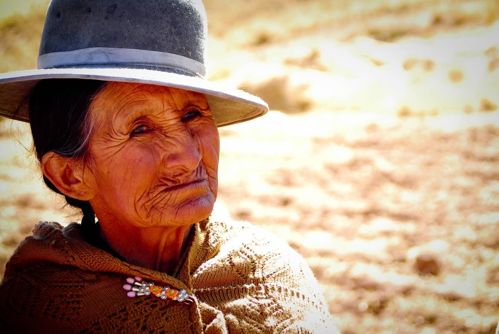 This Aymara woman lives on the cold arid plateau (the Altiplano) at almost 13,000 ft. She is a beneficiary of a community irrigation and water system which has brought safe water to her village; this vital development aims to improve health, provide food and generate income. Elle Masri