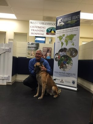 Retired Mine Detection Dog, Dino, with MLI's CEO