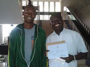 David and Abdul with the new certificate