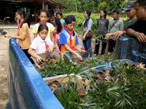 Nature Camp Participants Prepare to Plant Saplings