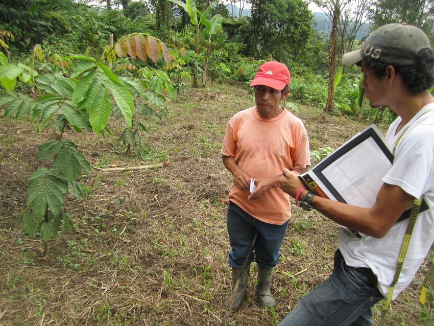 Team member talking to a local farmer