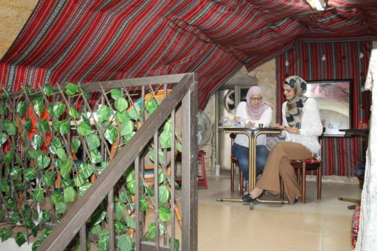 Work, pastries, and coffee at Bait Al Dyafa