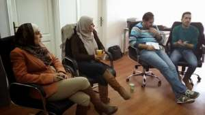 Sahar in a training and mentoring session