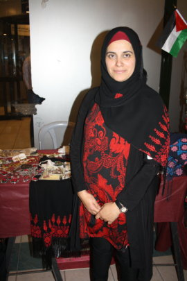 Sumood at an exhbition for her business Shal.