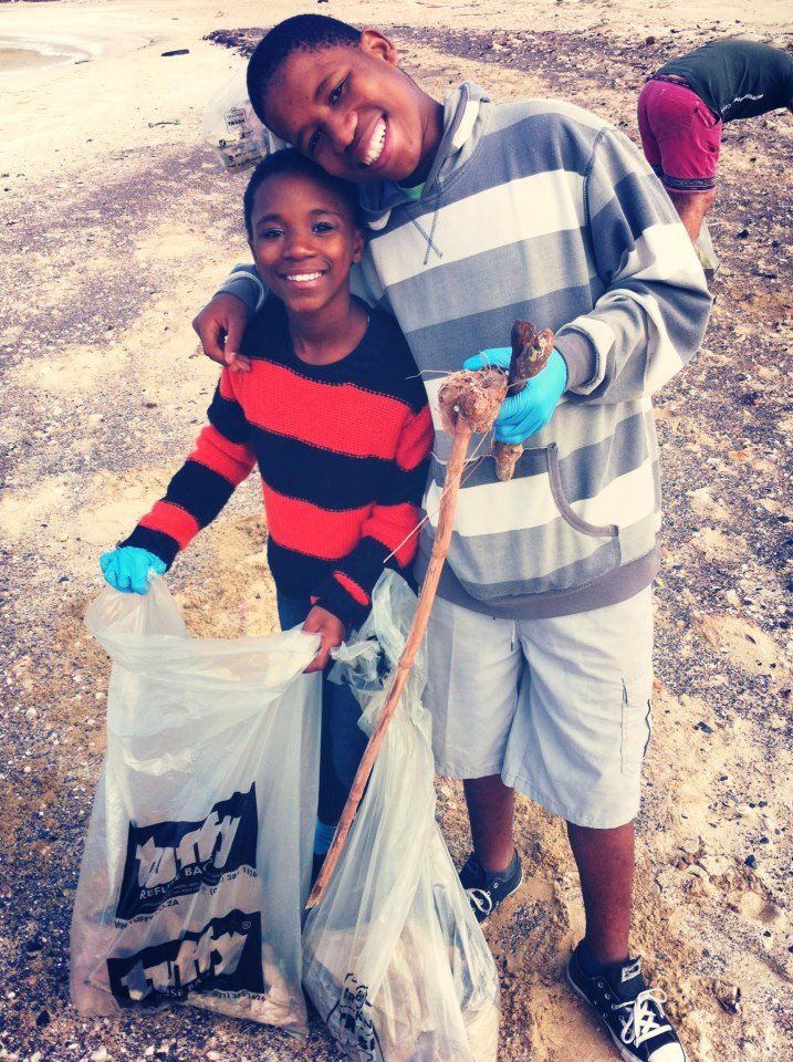 Two siblings taking part in a beach clean-up!