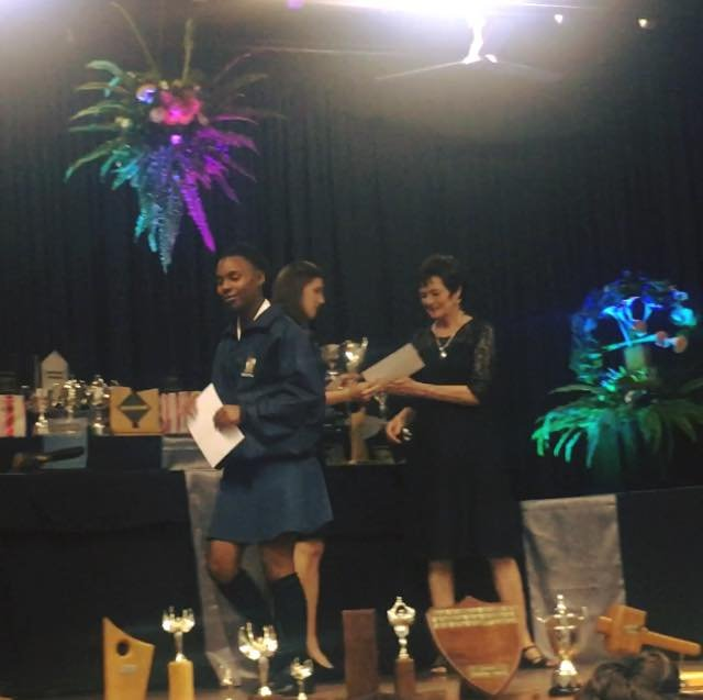 Collecting a prize for Top 5 academic achievement!