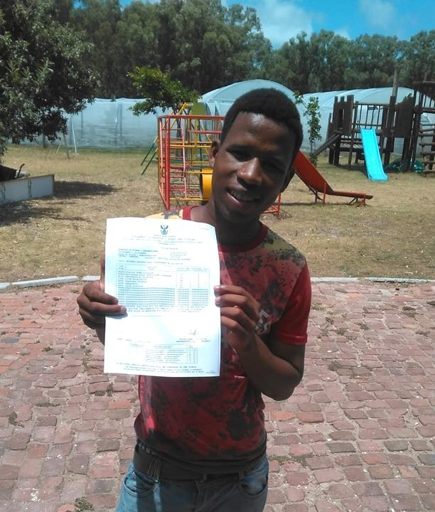 Our oldest boy beaming with his matric certificate