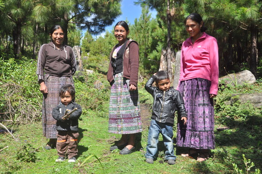 Mothers smiling with their sons in Guatemala.