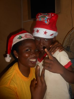 Ifeoma snaps with a sibling of the FLA Kids