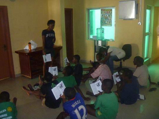 Yemi teaches them to read