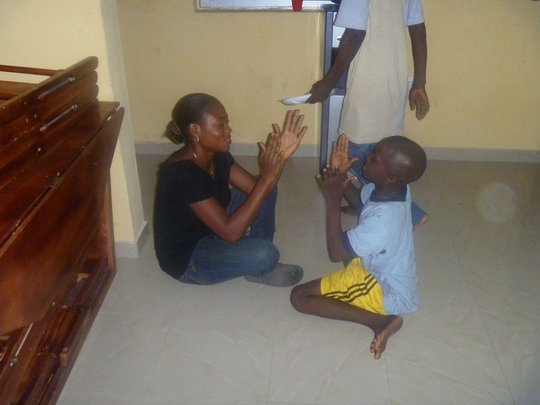 Tope (Support Worker) plays with Ted*