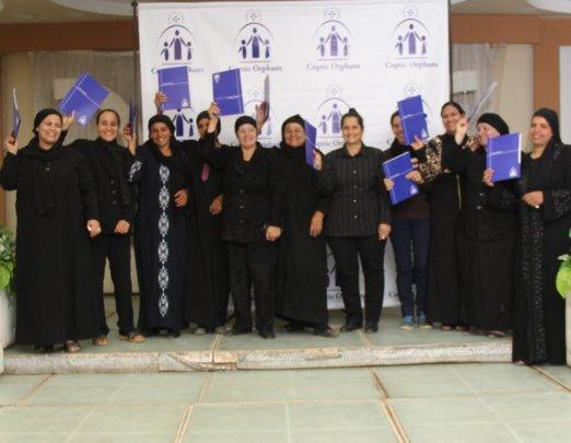 Widows receive their B'edaya microfinance loans.