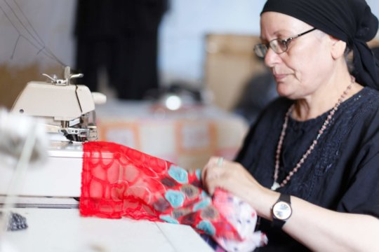 B'edaya mother during working in her business
