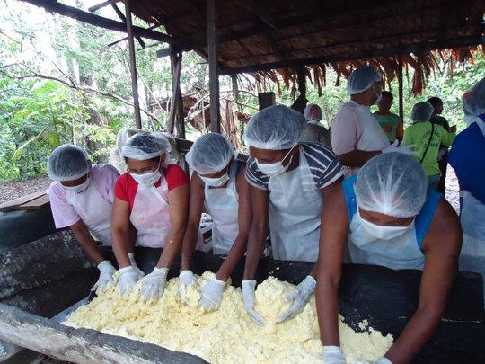 Women processing manioc in Para, Brazil