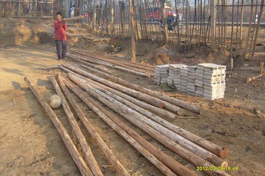 Wooden poles and bricks create the new DARE Center