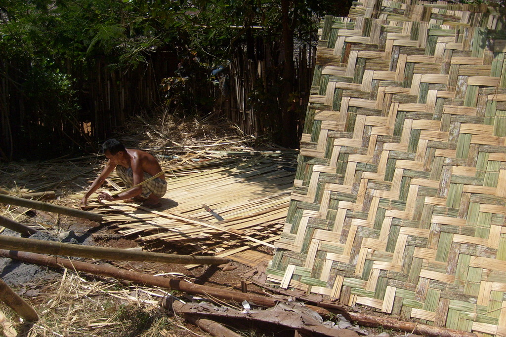 Its hard work! Weaving bamboo together.