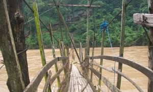 The river came high and damaged the walking bridge