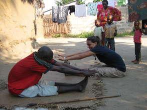 Volunteer Emily working with patient