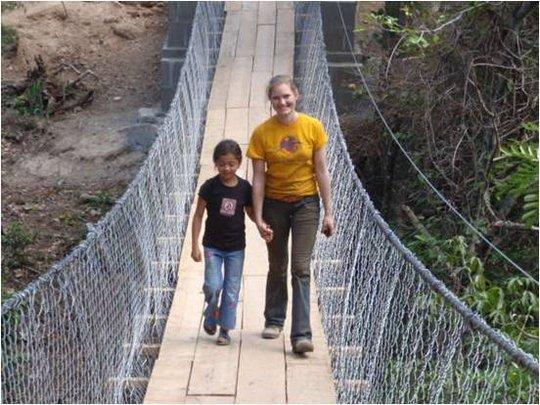 Project Leader Walks Across Bridge in El Panama