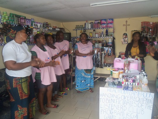 beneficaries gather to receive support