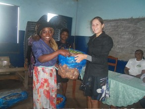 Bebeficiary receives item for petti trading