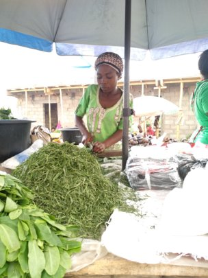 Joan an IDP program beneficiary in the market