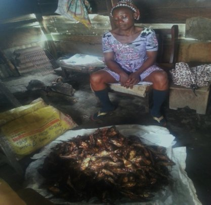 Shirlie with some of the fish she smokes and sells