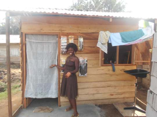 Becky, in front of the saloon you helped to build