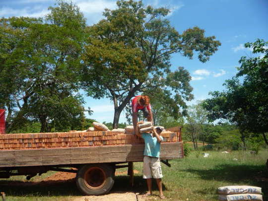 Lime and bricks being unloaded