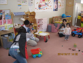 Mothers are busy playing with children.