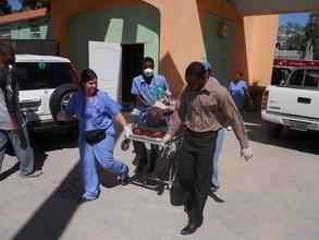 EMT's transporting critical patient (Medishare)