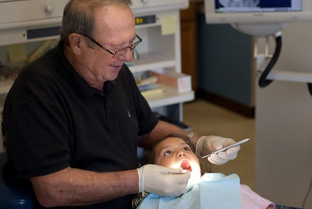 A young person receiving dental care in a SBHC