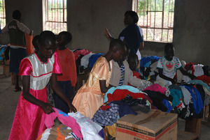 Distributing clothes that were donated to the kids