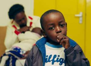 child and baby with Sickle Cell Disease at clinic