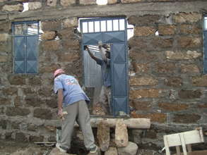 Installation of Front wall gate and windows.
