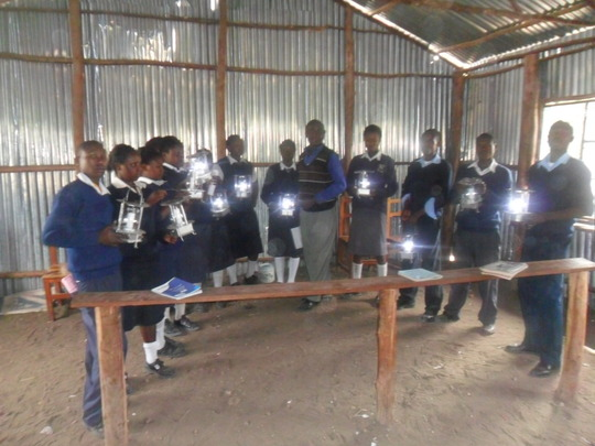 Some of the students pose with their new lamps