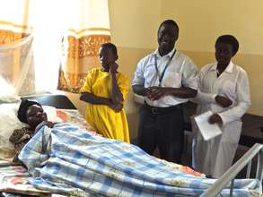 Malaria patient with daughter,Dr. Ronald,and nurse